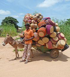 Vendor in Ghana on the way to market with a cart of bolga baskets. #fairtrade #bolga #ghana