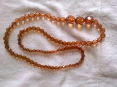 Rosângela Vig Artesanato e decoração: colar marrom, com pedrinhas brilhantes, 25,00
