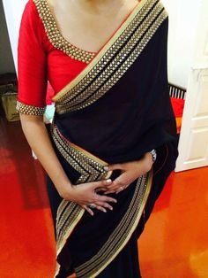 Love the contrasting saree blouse
