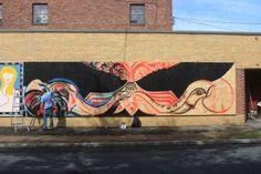 Geddes Jones works on his mural for the fifth annual O+ Festival, where artists and wellness practitioners exchange their gifts. (From the O+ Festival Facebook page.) N Front Street, Kingston, NY. #HudsonValley #mural #art