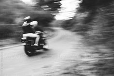 Engagement shoot, abstract couple on a motorcycle.  Isaiah & Taylor Photography for Stocksy United IsaiahAndTaylor.com