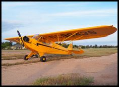 Piper J-3 Cub -  My Dad had a J-3 Cub when I was a kid like this one. Great memories of him taking me flying.