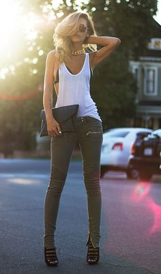 Green jeans with a white top, high heels, and a black clutch!