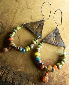 Rustic stamped copper triangle connectors, embellished with Czech and Indonesian colorful beads for a distinctive hoop earring design. Long and luscious mix of colors and textures in the earthy seed beads, with just the right touch of a Czech glass melon dangle on each earring. I have