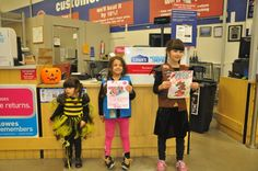 Girl Scout's from the Redmond, WA troop delivering over 30 cards to Lowe's on behalf of their fellow Brownies and Daisies asking the store to give bees treats, not tricks and stop selling bee-killing pesticides.