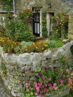 of Cottage and Garden, Yorkshire, England, United Kingdom, Europe Photographic Print by Woolfitt Adam Rock wall gardenRock wall garden Cottage Patio, Cottage Garden Design, French Cottage Garden, Small Cottage Garden Ideas, Garden Shrubs, Shade Garden, Rock Wall Gardens, Sloped Garden, Walled Garden