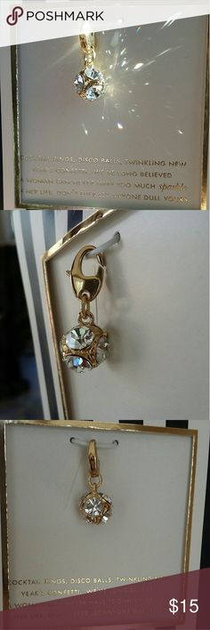 """Kate Spade Charm Kate Spade clear/gold charm, measuring 1 inch in length.  Photos were taken by the window so you could see the light bouncing off the """"disco"""" ball. kate spade Jewelry"""