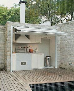 A different option for an outdoor kitchen... Keep it closed off from the elements, while still being easily accessible for entertaining at a moment's notice!