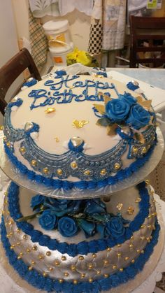 beautiful two layer birthday cake  with metallic sliver and goal with vintage mold trimmings