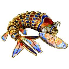 Victorian Era Chinese Red and Blue Enamel Gold Articulated Fish Pin | From a unique collection of vintage brooches at https://www.1stdibs.com/jewelry/brooches/brooches/