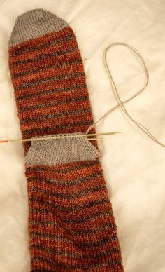 Knitting toe up socks with after thought heel.