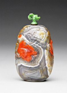 A Fine Carved Agate Snuff Bottle with Qilong