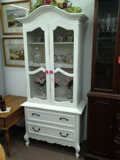 $149 - This petite Hutch has been painted white and the lightly distressed. Metal inserts in the doors , Rose knobs. The base has two drawers for storage. The cabinet measures 31 and a half inches across the front, 15 inches deep and it stands 68 inches to the tallest point. It can be seen in booth E5 at Main Street Antique Mall 7260 East Main St ( E of Power Rd ) Mesa 85207  480 9241122open 7 days 10 till 530 Cash or charge 30 day layaway also available