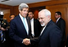 U.S. Secretary of State John Kerry shakes hands with Iranian Foreign Minister Mohammad Javad Zarif. Photo By: REUTERS