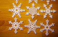 Snowflakes hama perler by Frøken Lyngsø Hama Beads Design, Hama Beads Patterns, Beading Patterns, Perler Bead Art, Perler Beads, Christmas Snowflakes, Christmas Diy, Beaded Cross Stitch, Fuse Beads