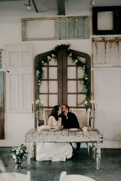 Eclectic Vintage Memphis Wedding at Propcellar | Wedding Reception Idea with Sweetheart Table and Vintage Doors | Real Wedding of an Anne Barge Bride featured on Junebug Weddings Blog
