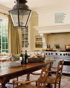 wendy posard's mediterranean cottage kitchen, love the warm palette and trimwork above the range