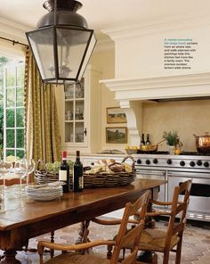 wendy posard's mediterranean cottage kitchen, love the warm palette and trimwork above the range