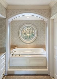 A jet bath with a rose window. What if you created french sliding doors, the ones that sit inside the wall when open, so that if you wanted to section the bath tub from the sinks, you could simply pull them closed? Not sure if it would work.