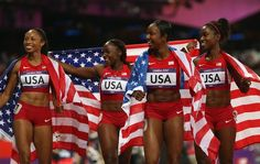 Carmelita Jeter, Bianca Knight, Allyson Felix, and Tianna Madison celebrate after winning gold in the Women's 4 x 100m Relay Final on Day 14.