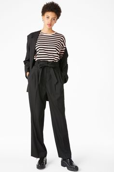 <p>Chic trousers crafted from a soft twill fabric, with front pleats and a super wide-leg. Ties together with a matching belt and the peplum style waistband