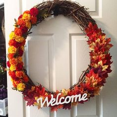24 inch grapevine wreath with welcome sign. mums and leaves. ready for fall. #awreathforyou