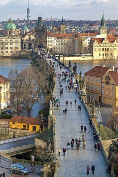 Charles Bridge - Prague, Czech Republic The bridge is lined with statues of saints and various religious figures.