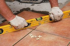 How to Lay Tile over Concrete | DoItYourself.com