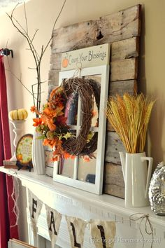 Fall mantel {decorated with reclaimed pallet wood} | The Frugal Homemaker