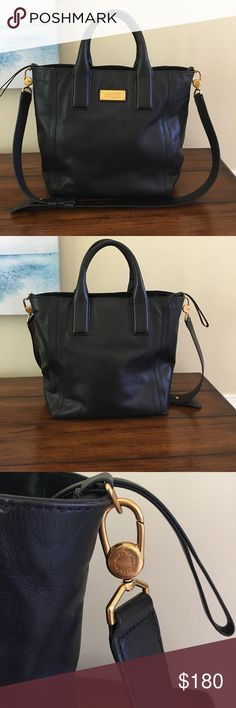 Marc by Marc Jacobs black bag Marc by Marc Jacobs black hand bag. I used this for about a year...there is a small sign of wear at the bottom of the bag as shown in pictures but otherwise in great condition! Love this bag and received tons of compliments! Marc By Marc Jacobs Bags