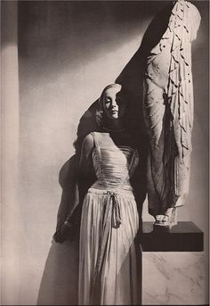 "Evening gown by Maggy Rouff, ""Harper's Bazaar,"" September 1939. Photo by George Hoyningen-Huene."