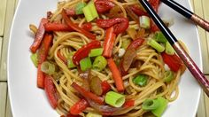 Spaghetti and vegetables in a sauce made with soy sauce, teriyaki sauce, honey, and ginger makes a quick and easy Asian-style noodle dish.