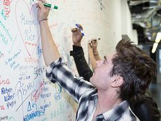 Zac signs the wall at Facebook HQ on January 14, 2014