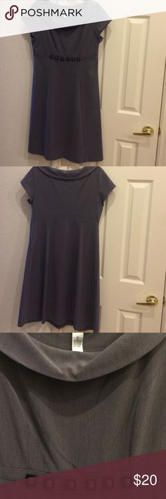"""Beautiful Dress What a wonderful gray dress with black decorative square tiles in the front. It is  40"""" long from the shoulder and 27"""" from the midriff. It is made of 75% polyester, 22% rayon, and 3% spandex. It has a zipper closure on the left side under the arm as pictures. All reasonable offers are considered. Amanda Lane Dresses Midi"""