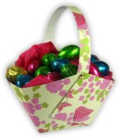 It is so quick to make too. All you need is a square sheet of paper or card, and some scissors and glue. Make a few snips and folds, and in literally five minutes you'll have a lovely homemade Easter basket that you can fill with chocolates or other Easter gifts!