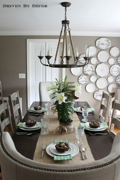 From Driven by Decor. Love the wing chairs at both ends of the dining table and the fabulous arrangement of plates on the wall.