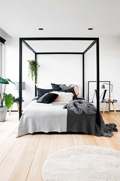 Master #bedroom with a #modern poster bed frame and lots of layered textures
