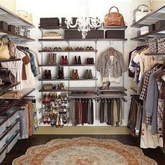 Closet Design. Great flow and organization  I love an Organized Closet. Chandelier and oval rug add to the ambiance.