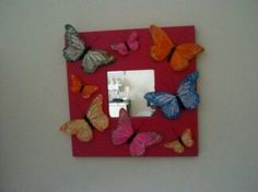 Painted and Ikea Mirror and glued butterfly's on it.