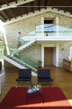 Amazing Glass Stair Railing and Modern Stone Wall!  Glass stairwell, focal wall behind (maybe current design?)