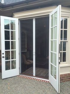 "We are seeing more and more homes that feature ""out-swinging"" French doors. Did you know that French doors that swing outward are even required by the building codes in the state of Florida? After Hurricane Andrew hit, it became a sa French Doors With Screens, Sliding Screen Doors, French Doors Patio, Sliding Glass Door, Windows And Doors, Glass Doors, French Doors Bedroom, Patio Doors With Blinds, Door With Window"