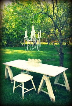 old door, saw horses (instead buy legs i can put on) mason jars, chandelier and pearls...my backyard picnic table
