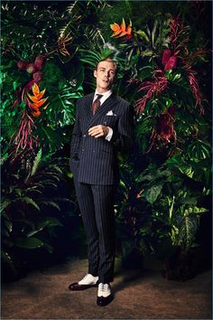 Donning a pinstripe suit, David Schütter appears in Rooks & Rocks' spring-summer 2018 lookbook.
