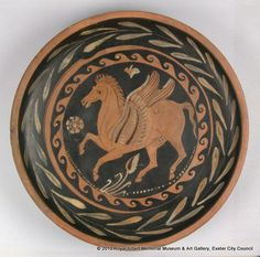 phiale Antiquities  The image on this plate is a pegasus or winged horse, which was a popular mythical creature in ancient Greece.