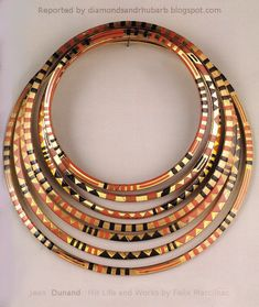 Neck rings by Jean Dunand, circa 1927, Gold plated, inlaid with lacquer. Jean Dunand was a Swiss lacquer, sculptor, dinandier and interior designer. He is considered the greatest lacquer artist of the Art Deco period.