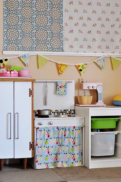 our play kitchen and playroom, full of DIY projects