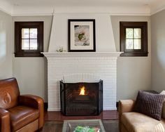 Design ideas for a traditional enclosed living room in Chicago with beige walls, a standard fireplace and a brick fireplace surround. Description from houzz.com. I searched for this on bing.com/images