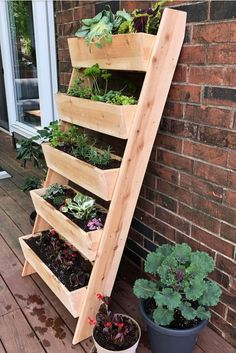 Create a magical patio space with a vertical cedar ladder planter. The vertical set-up is a space saving way to grow a wall of cascading flowers or strawberries, vegetables or herbs, especially if you have limited outdoor space or live in an apartment. Garden Ladder, Herb Garden Pallet, Diy Herb Garden, Verticle Herb Garden, Diy Pallet Vertical Garden, Plant Ladder, Vertical Vegetable Gardens, Small Herb Gardens, Cedar Garden