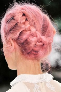 Lovely pastel crown braid. Reach this shade by bleaching your hair to its lightest blonde, then mixing Manic Panic Cotton Candy Pink with Manic Panic Pastelizer for a soft hue.
