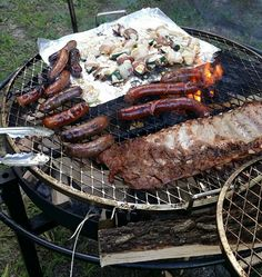 Arkansas backyard BBQ sausage brats ribs and bacon wraped stuffed (homemade peach cream cheese) jalapeños. [10801143]